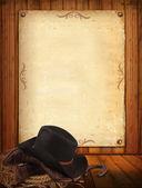 Fond ouest avec des vêtements de cow-boy et des vieux papiers pour texte — Photo