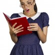 Surprised young woman with eyeglasses and book .Pretty student i — Stock Photo