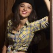 Smiling young cowgirl beautiful woman in cowboy hat — Stock Photo