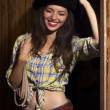 Cowgirl in black cowboy hat.Beautiful laughing young woman with  — Stock Photo