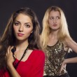 Two beautifull young women in fashion clothes and long hairs — Stock Photo