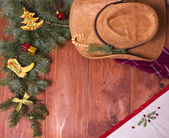 Cowboy Christmas wood background with holiday decorations — Stock Photo
