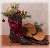 Cowboy clothes with Christmas objects — Stock Photo