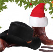 Stock Photo: Americblack hat with cowboy boots.Christmas objects isolated