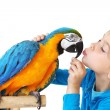 Child with ara parrot — Stock Photo #14123227