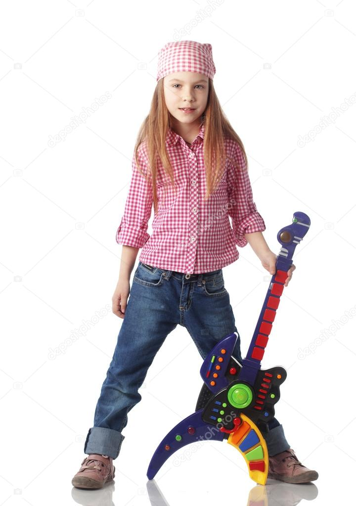 A little girl with a toy guitar isolated on white background  Stock Photo #14963761