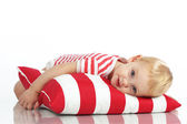Child lying with pillow — Foto Stock