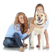 Woman and girl with a dog - Stock Photo