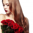 Stock Photo: Beautiful girl holding bunch of roses