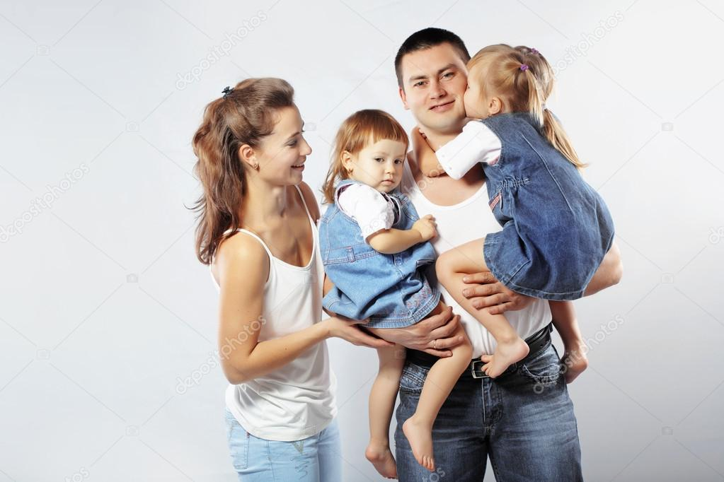 Beautiful young family happy with their kids  Foto Stock #18728515
