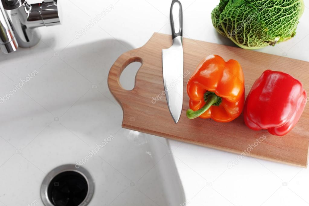 Fresh vegetables on a white kitchen table — Stock Photo #20719533