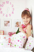 Kid girl with gift boxes — Stock Photo