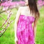 Woman in spring garden — Stock Photo