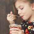 Stock Photo: Child eating dessert