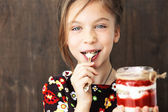 Child eating dessert — Stock Photo