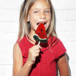 Child eating lollipop — Stock Photo