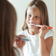 Girl brushes teeth — Stock Photo
