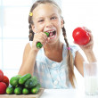 Child eating vegetables — Stock Photo