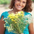 Girl holding bouquet of flowers — Stock Photo #30408657