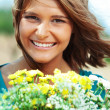 Stock Photo: Girl holding bouquet of flowers