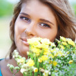 Girl holding bouquet of flowers — Stock Photo
