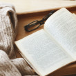 Book and sweater — Stock Photo