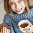 Child drinking tea — Stock Photo