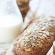 Cereal bread and milk — Stock Photo