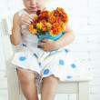 Stock Photo: Child with flowers