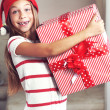 Child holding big gift — Stock Photo