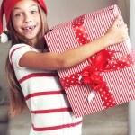 Child holding big gift — Stock Photo