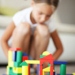 Stock Photo: Child playing with blocks
