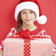 Child holding big gift — Stock Photo #35264933
