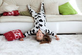 Child in cow print pajamas — Stock Photo