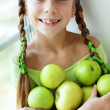 Little girl eating apples — Stok fotoğraf