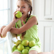 Little girl eating apples — Stock Photo #35867967