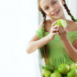 Little girl eating apples — Stock fotografie #35867981
