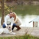 Couple with dog — Stock Photo