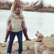 Stock Photo: Couple with dog