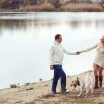 Couple with dog — Stock Photo #36006459