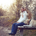 Couple with dog — Stock Photo #36006465