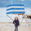 Child walking near the sea — Stock Photo