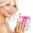Young woman holding gift — Stockfoto #3902306