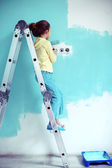 Child painting the wall — Stock Photo