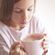 Child drinking cocoa — Stock Photo #40760053