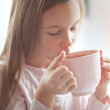 Child drinking cocoa — Stock Photo #40760215