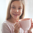 Child drinking cocoa — Stock Photo #40760293