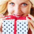 Woman holding gift — Stock Photo #4222849