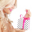 Young woman holding gift — Stock Photo #4223032