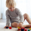 Toddler playing with wooden blocks — Stock Photo